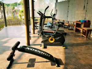 The fitness center and/or fitness facilities at The Mud Bamboo cafe and Beds