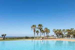 The swimming pool at or near Salgados Dunas Suites