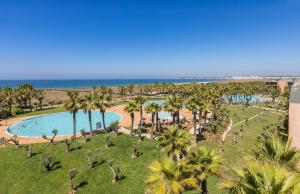 A view of the pool at Salgados Dunas Suites or nearby