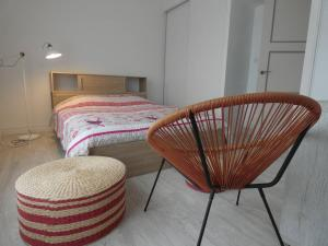 A bed or beds in a room at La Surprise