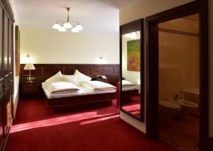 Cama o camas de una habitación en Hotel Batzenhäusl