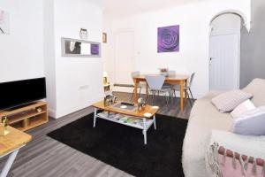 A seating area at Townhouse @ Hanley Road Stoke