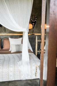 A bed or beds in a room at Village Bali
