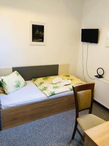 Кровать или кровати в номере Hotel Piast