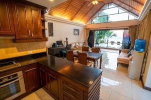 A kitchen or kitchenette at Beachfront Villa 2 Bedrooms with Private Pool