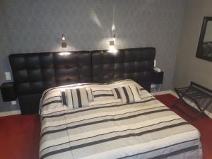 Un ou plusieurs lits dans un hébergement de l'établissement Hôtel de La Croix d'Or