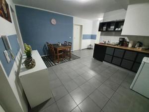 A kitchen or kitchenette at White Pearl Hostel 2