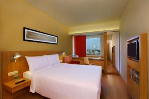 A bed or beds in a room at ibis Jaipur Civil Lines