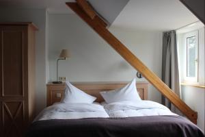 Ein Bett oder Betten in einem Zimmer der Unterkunft BE BIO Hotel be active