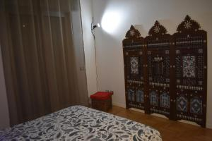 A bed or beds in a room at Appartamenti Bruzzanese