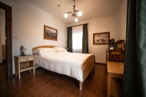 Cama o camas de una habitación en Hotel Panda-Disponibile stazione ricarica auto elettriche