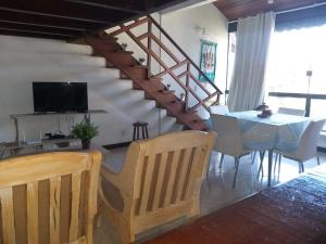 A television and/or entertainment center at Duplex Top! - Visit and Love Us - Piccola Marina Bracuhy