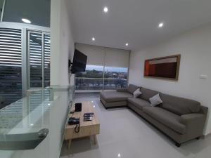 A seating area at Departamento 2hab en Piura