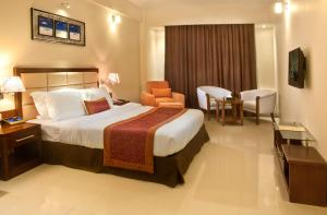 A bed or beds in a room at Royal Tulip Sea Pearl Beach Resort & Spa Cox's Bazar