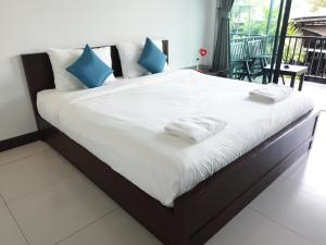 Cama o camas de una habitación en The Nidhra Boutique Resort
