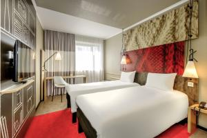 Кровать или кровати в номере ibis Aachen Marschiertor - Aix-la-Chapelle