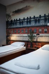Łóżko lub łóżka w pokoju w obiekcie Hostel Flamingo Centrum