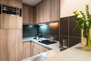 A kitchen or kitchenette at Aparthotel Adagio Berlin Kurfürstendamm