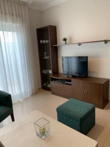 Una televisión o centro de entretenimiento en Apartamentos Illa