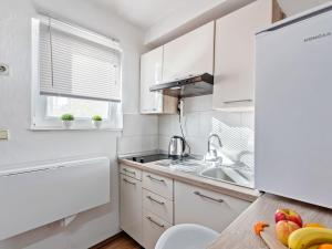 A kitchen or kitchenette at Cosy Holiday Home in Zadar with Garden