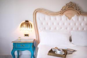 Кровать или кровати в номере Mitsis Laguna Resort & Spa