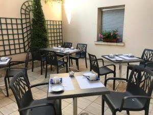 Restaurant ou autre lieu de restauration dans l'établissement Hôtel du Lion