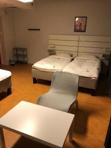 Säng eller sängar i ett rum på Sleep And Go