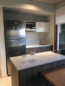 Una cocina o kitchenette en BTWINS , PINAMAR