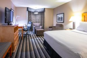 A television and/or entertainment center at Royal Hotel West Edmonton, Trademark Collection by Wyndham