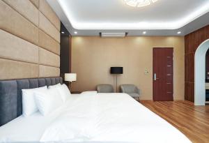 Кровать или кровати в номере BBQ Hostel Ha Long 2