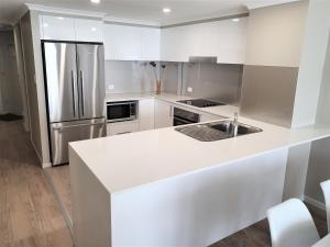 A kitchen or kitchenette at Kirra Beach Apartments