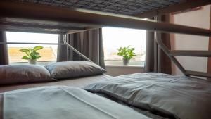 A bed or beds in a room at The Escape