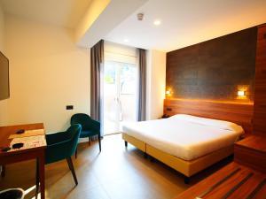 Ένα ή περισσότερα κρεβάτια σε δωμάτιο στο Kolping Hotel Casa Domitilla