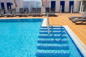 The swimming pool at or near TAO El Cotillo