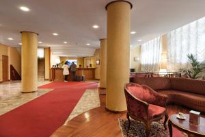The lobby or reception area at Hotel De Paris