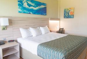 A bed or beds in a room at Punta Borinquen Resort