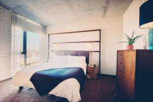 A bed or beds in a room at South Congress Hotel