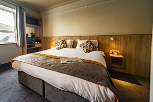 Cama ou camas em um quarto em The Old Quarter Townhouse