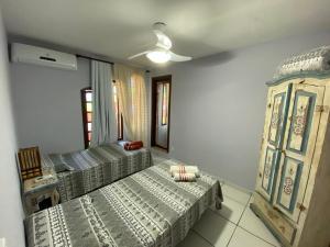 Cama ou camas em um quarto em Mahalo Guest House