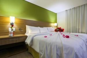 A bed or beds in a room at Radisson Hotel Belém
