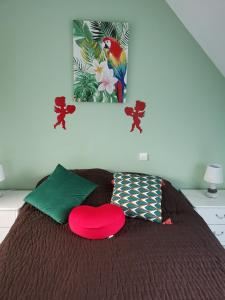 A bed or beds in a room at Les gites Haras Del Paradiso