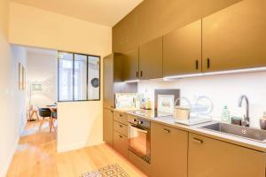 A kitchen or kitchenette at Le Franklin Roosevelt