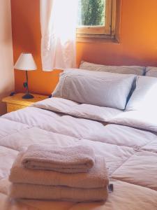 Una cama o camas en una habitación de Terrazas de Uspallata