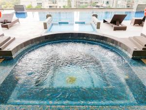 The swimming pool at or near GM Serviced Apartment (SHA Certified)