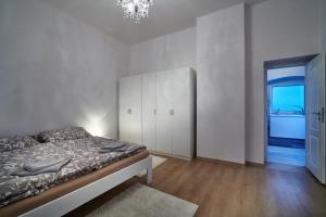 Posteľ alebo postele v izbe v ubytovaní Apartmán BB centrum