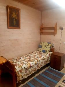 Кровать или кровати в номере Золотая Рыбка