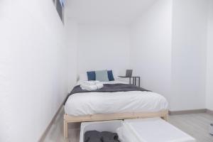 A bed or beds in a room at Valencia Spot Cheap