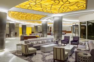 O saguão ou recepção de Millennium Hail Hotel