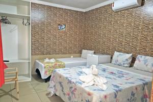 Cama ou camas em um quarto em Pousada Recanto Lara Mar