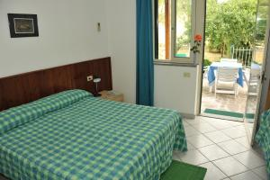A bed or beds in a room at Hotel Edera
